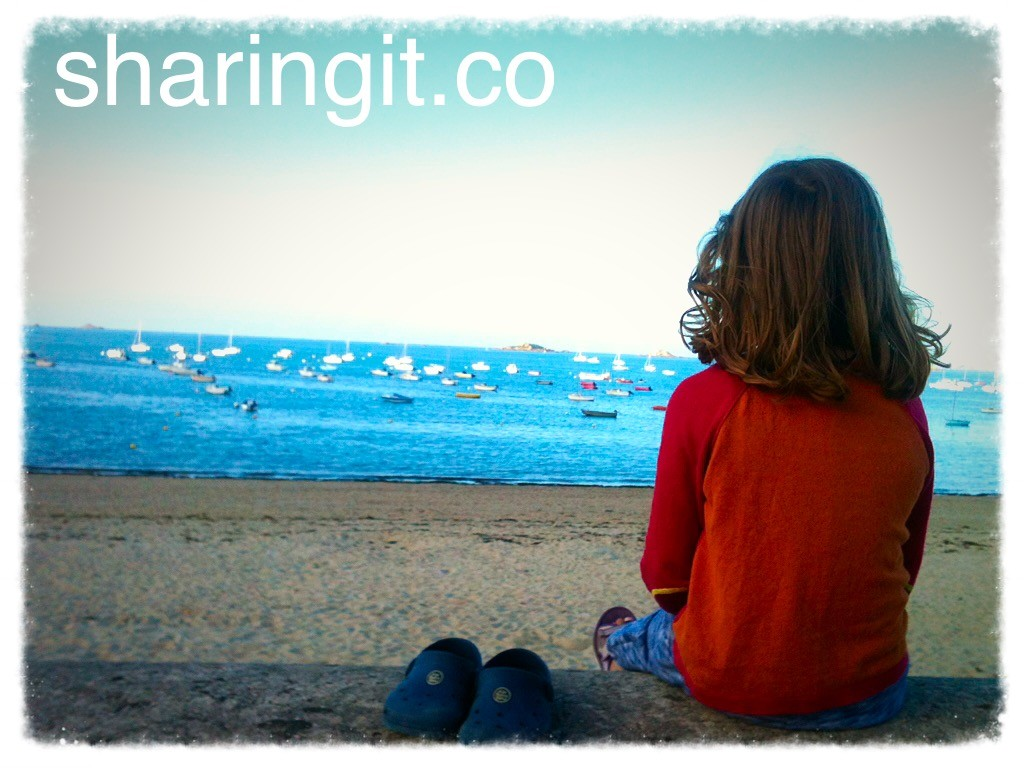 Child looking out to at sea